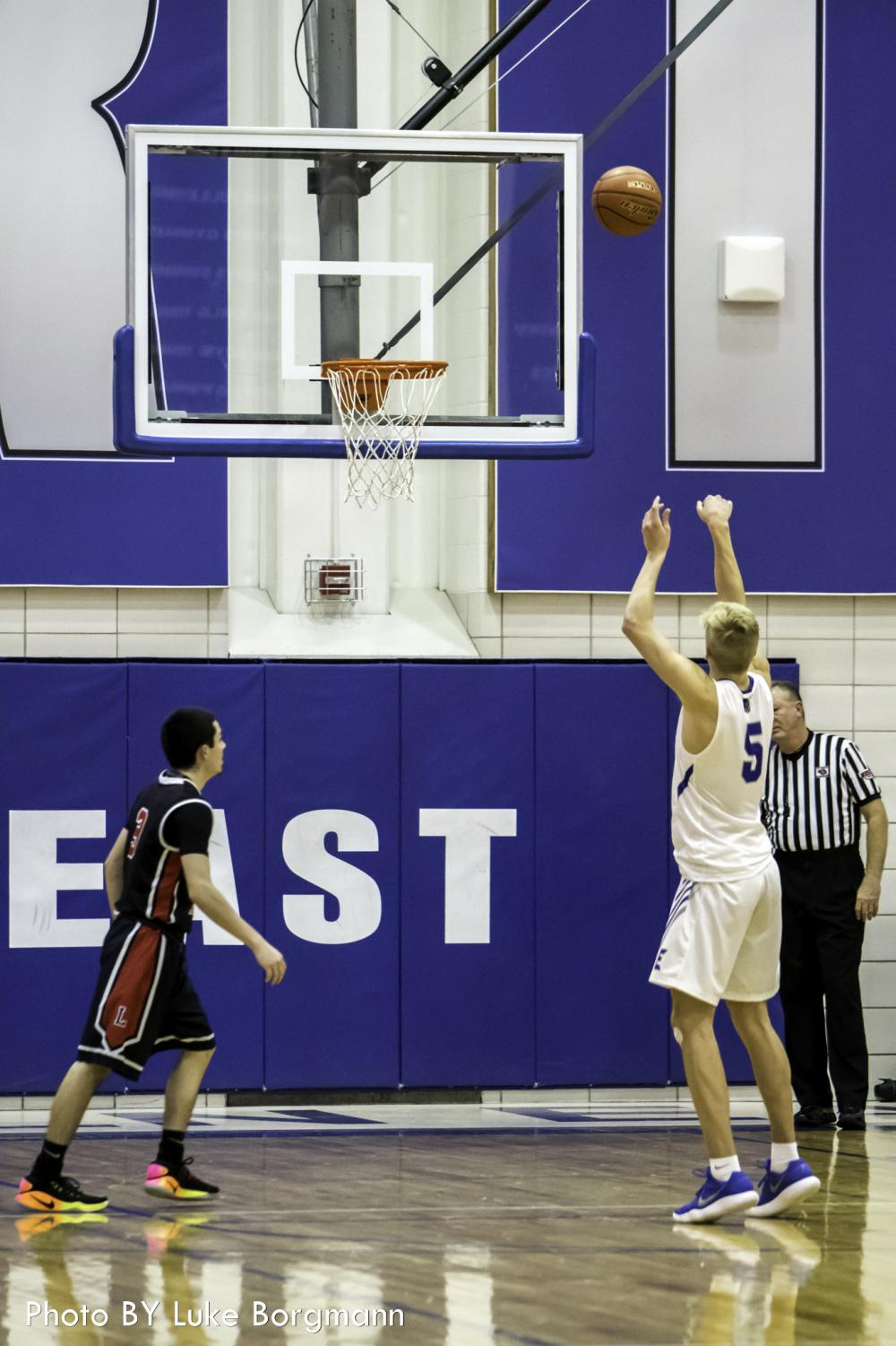 Lincoln East senior forward Sam Griesel (5) shoots a free throw against Lincoln High in the HAC tournament on December 29 at Lincoln East High School.
