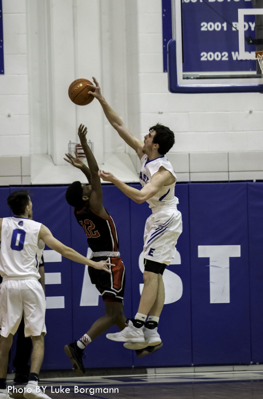 Jordan Janssen blocks Lincoln High junior Morgan Perry III during the HAC tournament on December 29.