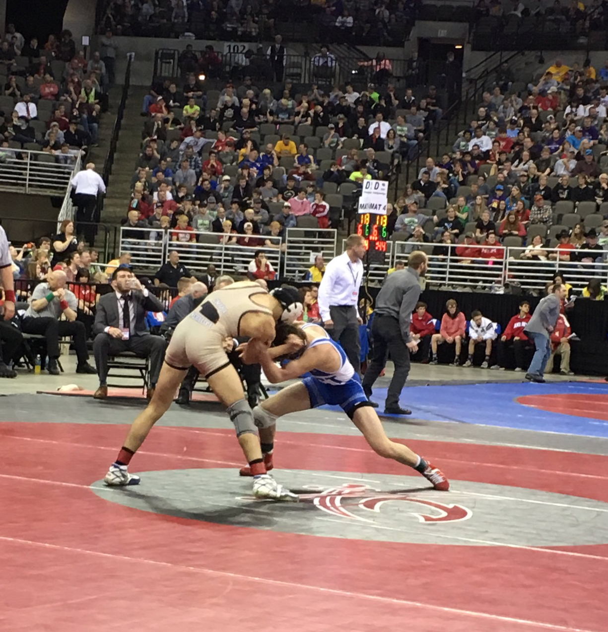 Maxx Mayfield competes against Omaha Burke's Joey Harrison in state final competition on February 18, 2017 at the Centurylink Center.