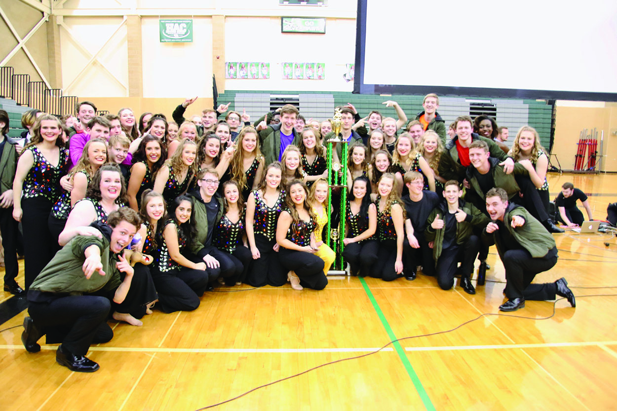 Express with their Grand Champion trophy at the Southwest Competition.