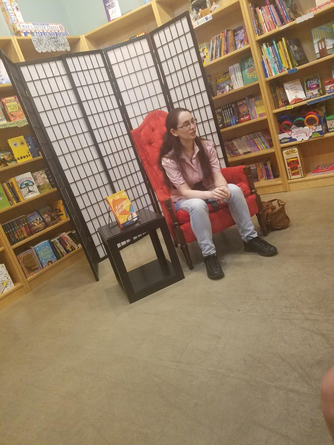 J. S. Puller talks to her readers while sitting on her throne at Indigo Bridge Books on Friday, May 11th.