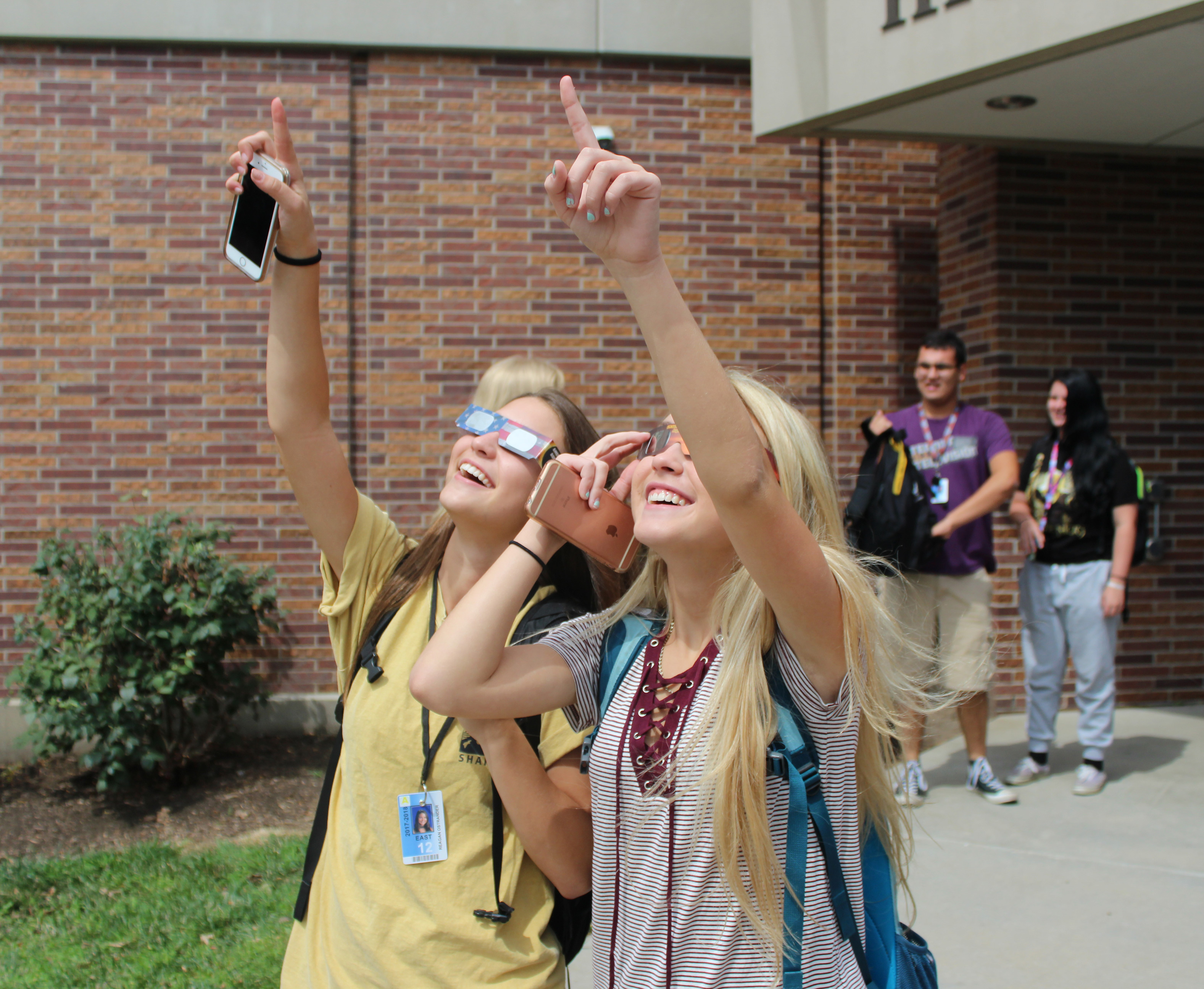 Two East high senior watch in awe at the start of the eclipse on Monday August 21. All LPS schools took a break to watch the memorable event. Photo by Nick Rippe