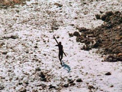 A Sentenilese man wards off a helicopter flying over the island.