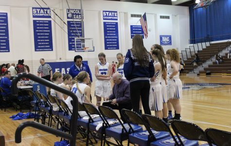 Easts girls JV team, call a time out and discuss a play during their game.