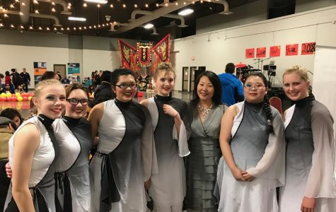 The Lincoln East Lunar Lotuses pose with the ACCC Cultural Program Coordinator, Rebecca Reinhardt, for a picture after their performance at the Lincoln Room of the Lancaster Event Center on Sunday, Feb. 25, 2018. Left to Right: Elise Benson (9), Angelina Nahorny (11), Angel Trinh (12), Beth Nipper (10), Rebecca Reinhardt, Yiling Zuo (10), and Ava Winjum(10). [Member Chloe Weakly (10) is not pictured]. Photo Courtesy of Rebecca Reinhardt.