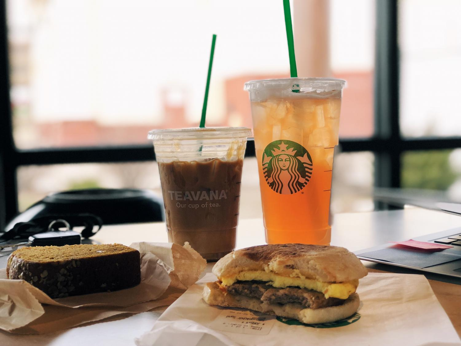 This delicious Starbucks spread features an iced coffee, iced tea, a pumpkin loaf and a sausage breakfast sandwich.
