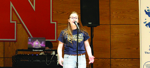 Shealyn+Warrick+%2811%29+performs+her+poem+%22Weeds%22+at+the+team%27s+second+preliminary+bout.+