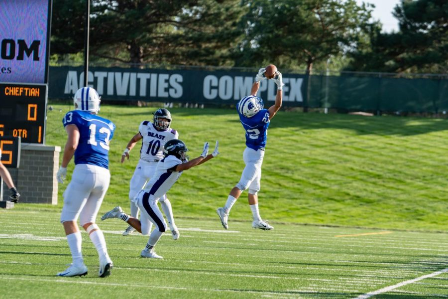 Lincoln+East+receiver+Kaleb+Brady+extends+for+a+catch+against+Bellevue+East+Thursday+afternoon.