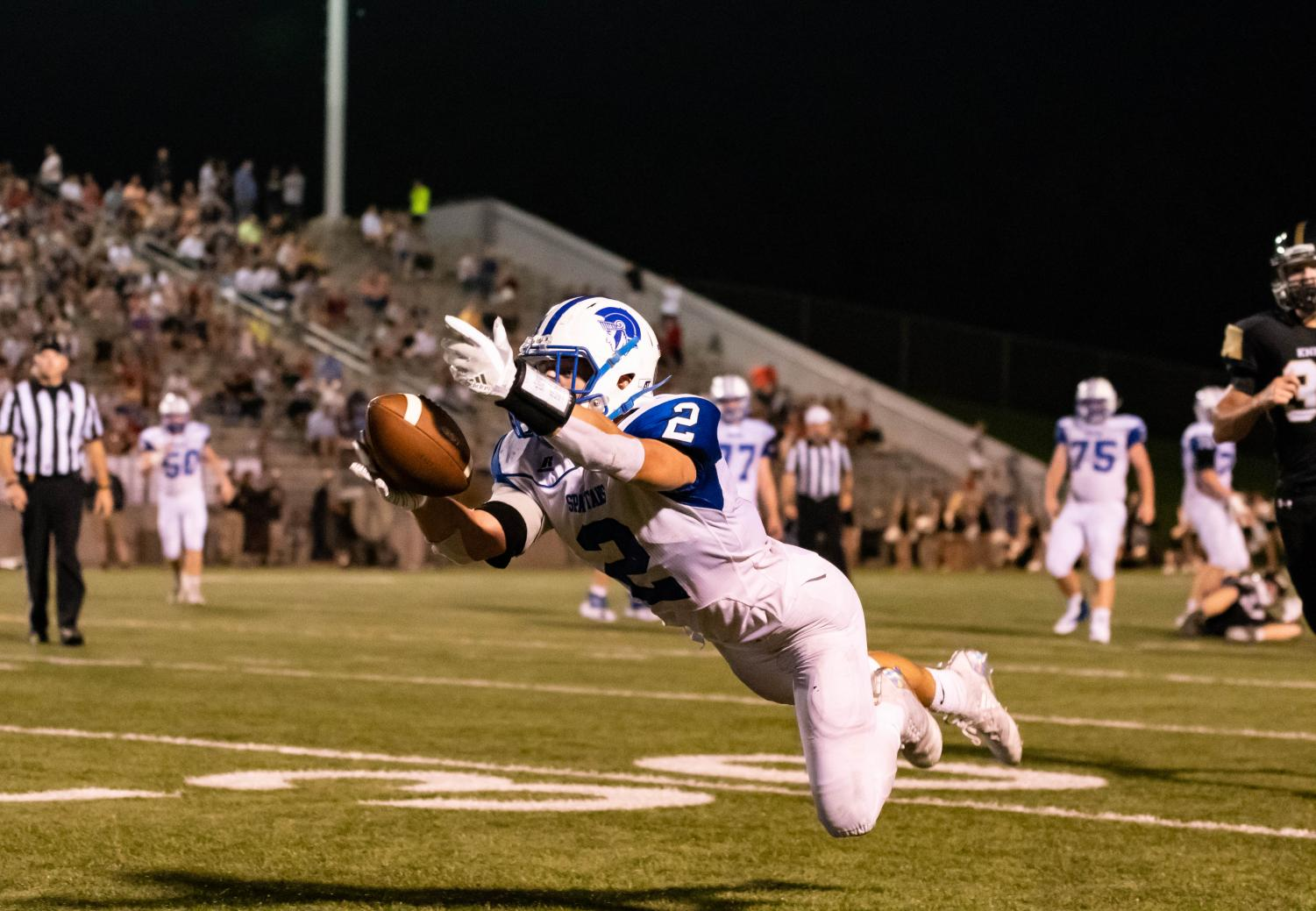 East senior AJ Muthersbaugh attempts to catch a pass vs. Southeast on Friday, September 14th at Seacrest Field.  Southeast won the game 14-12.