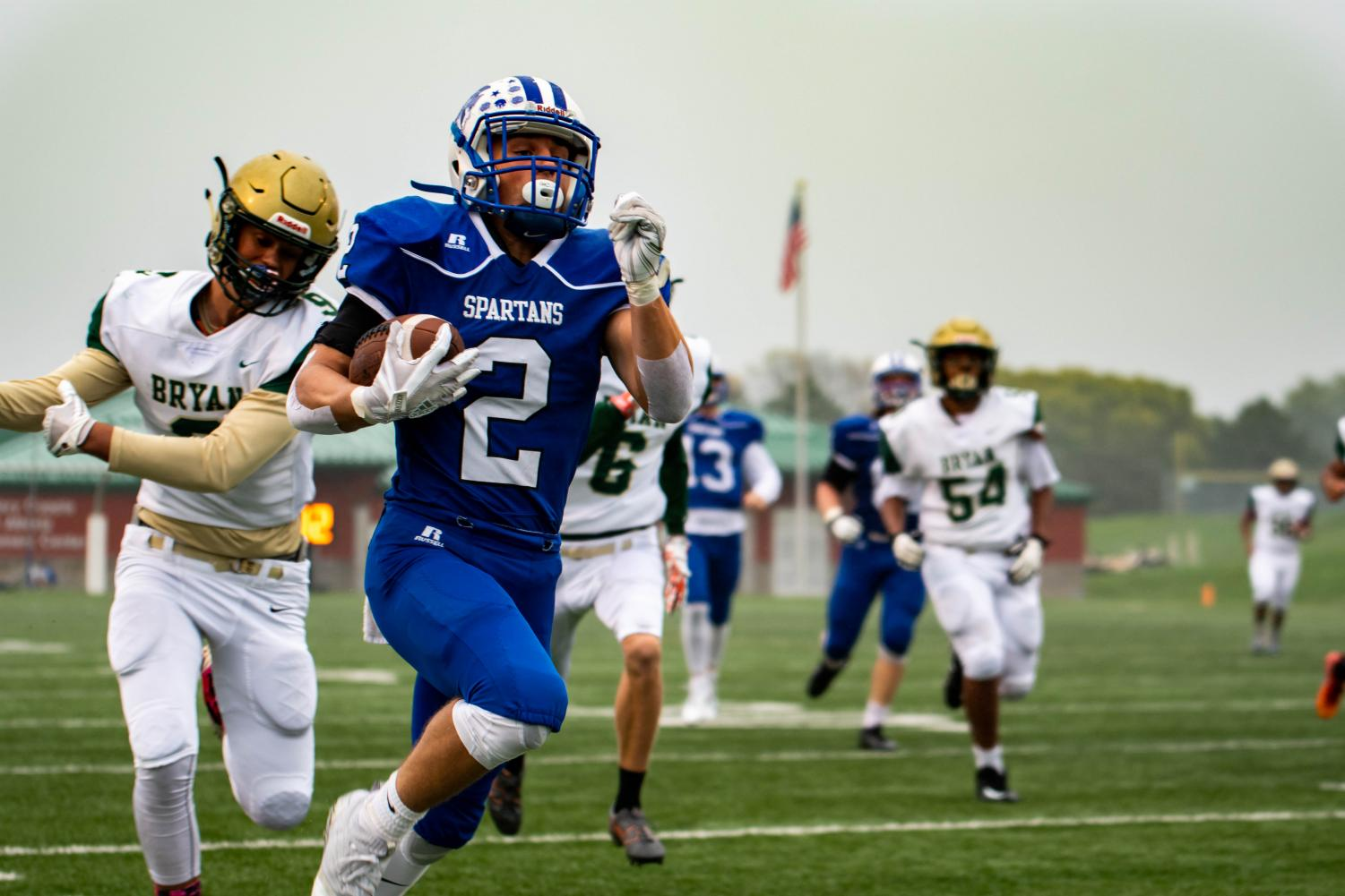 Lincoln East's AJ Muthersbaugh rushes for a touchdown Friday afternoon against Omaha Bryan.