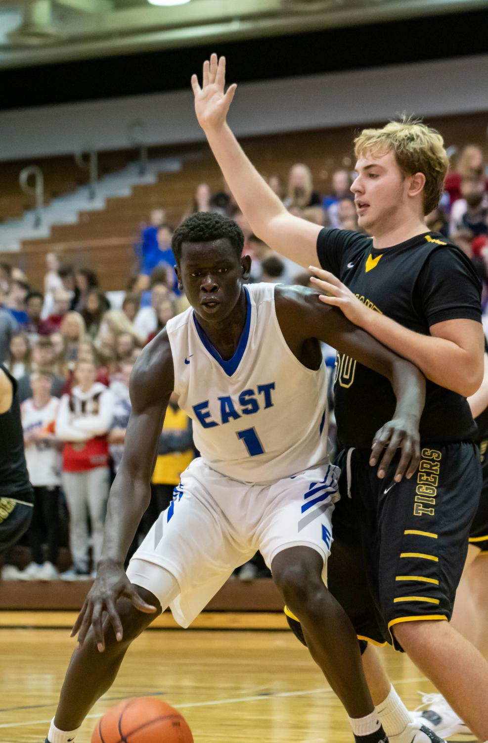 Teny Gakdeng works his way to the basket in the 63-40 win over Fremont on Thursday night.