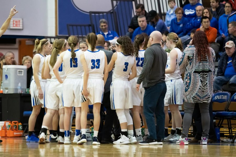 The+Spartan+girls+basketball+team+huddles+during+a+time+out+to+talk+things+over+in+their+52-37+win+over+Lincoln+High+on+Saturday+night.