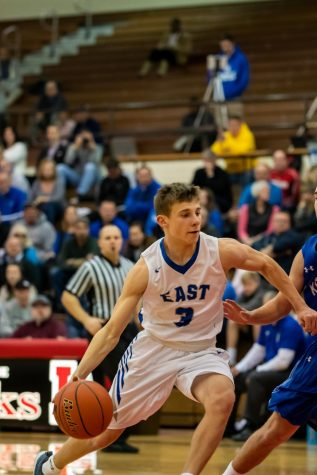 East sophomore point guard Carter Glenn attempts to drive the lane in the HAC Tournament against Kearney.