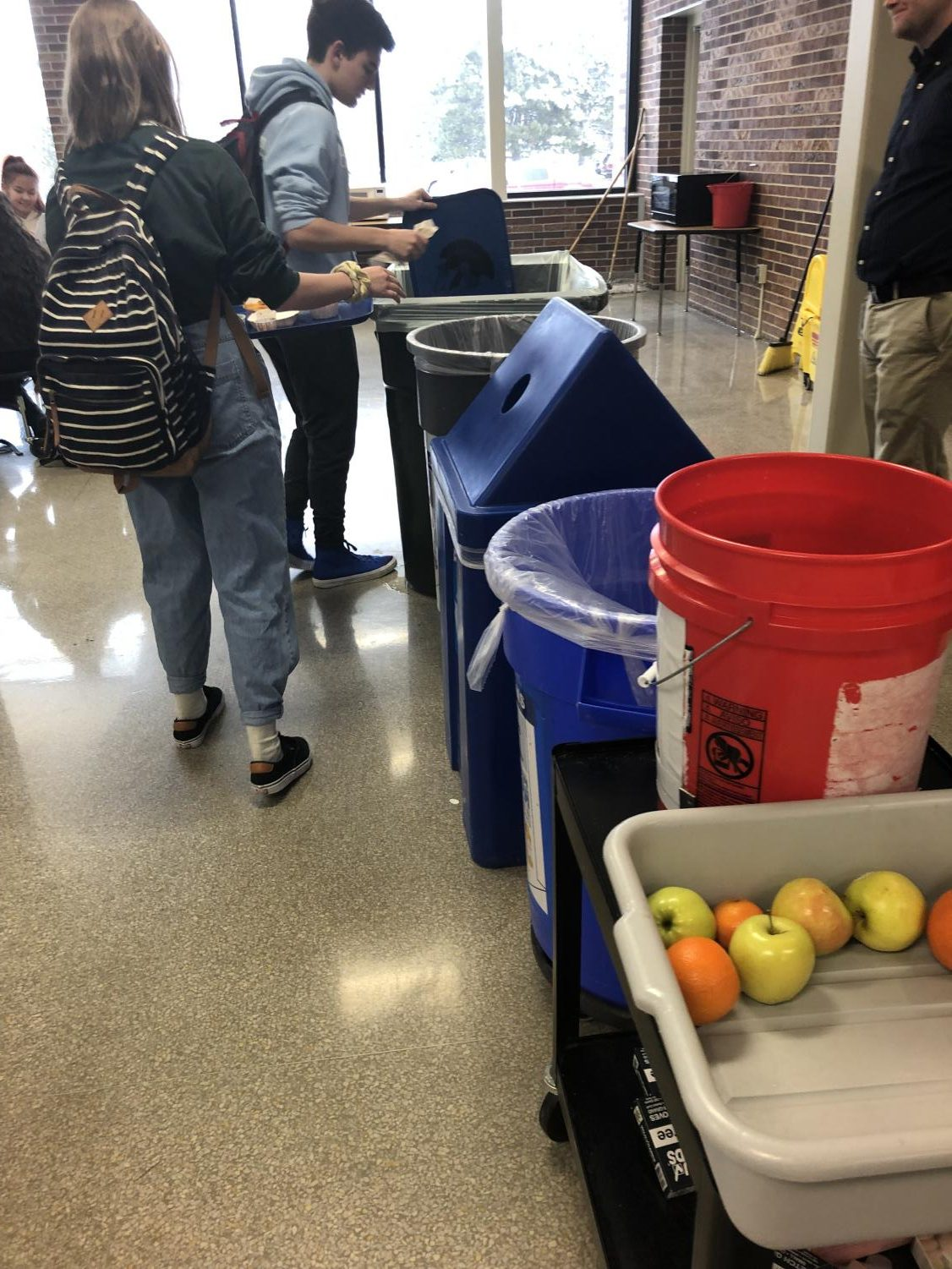 Students line up to test out the new procedure for lunch waste.  This method is meant to help our environment, beginning with schools within the LPS district.