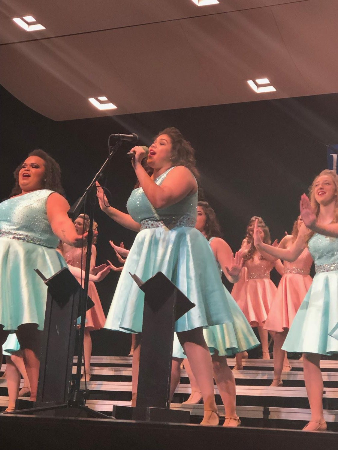 East High's Elegance first soloist Celeste Hellbusch singing at in the exhibition performance at Spartan Spectacular on Saturday, January 26.