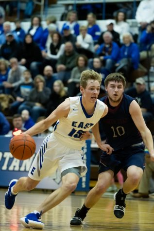 Spartan senior guard Connor Riekenberg drives past Gator junior guard Luke Juracek. The Spartans lost to the Gators 78-73.