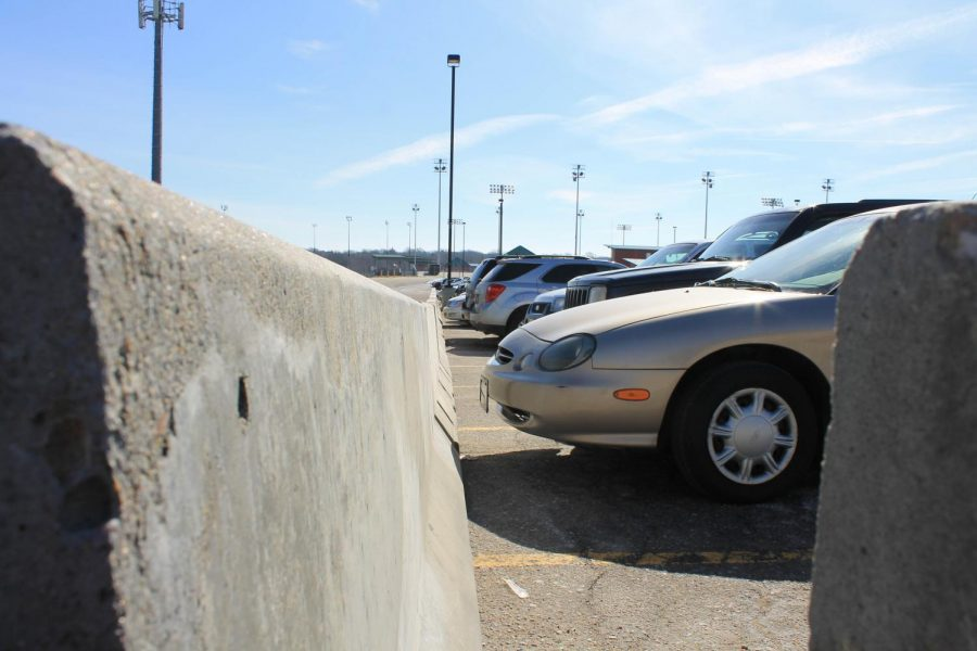 East students upset over new parking barriers