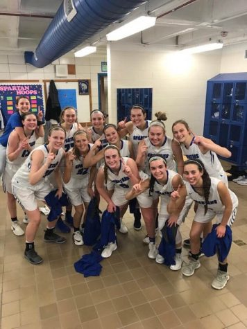 The Lincoln East girls varsity basketball team after a regular season win.