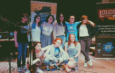 The Lincoln East Slam Poetry team poses at their recent competition at The Bay in Lincoln.