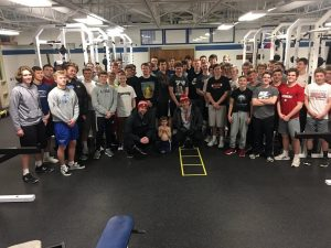 The Lincoln East baseball team poses for a group photo after a workout one afternoon, big expectations are in place after the hiring of new head coach Mychal Lanik.