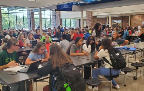 East High students eating lunch in the crowded cafeteria.