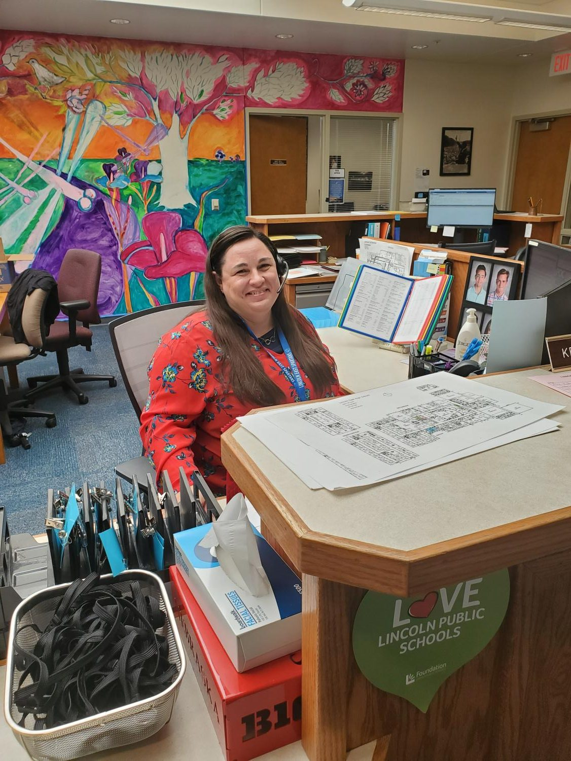 Ms. Manzitto working at her desk in the East main office.
