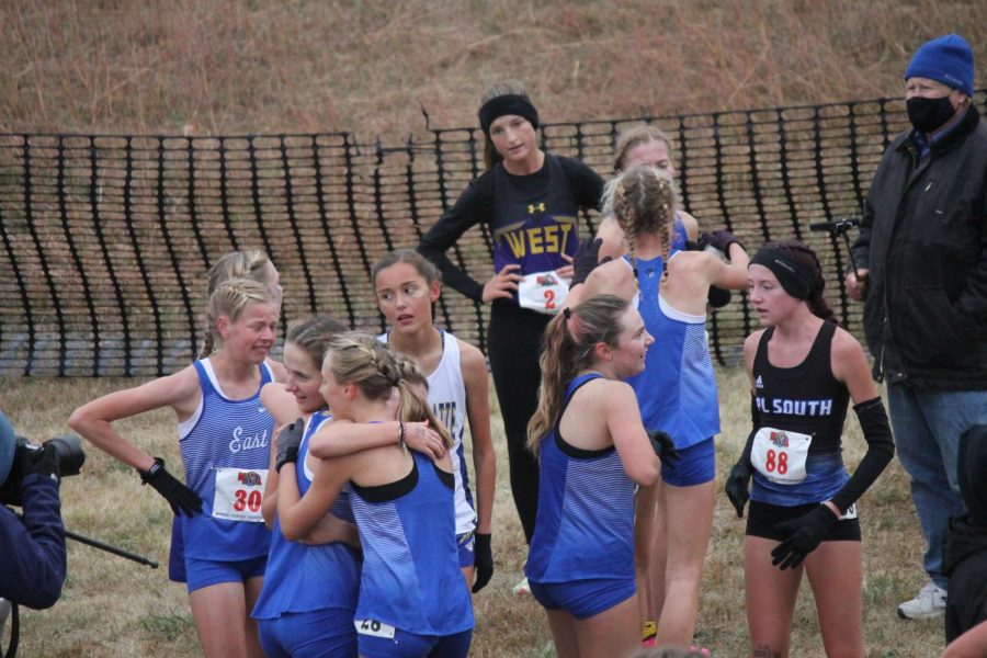 The Lady Spartans celebrate with one another after finding out they have won the state title.
