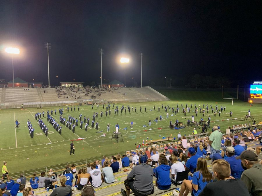 The Lincoln East Varsity Marching Band performs their show, Boy Band Legacy, for halftime at a football game.