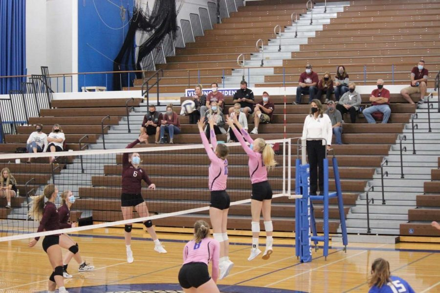 Brooklyn Fuchs and Annalee Ventling-Brown look to block a hit from Norfolk.