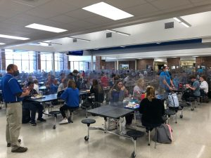 East High School students eating between dividers in the school cafeteria. These dividers have been mandated by LPS to block the spread of COVID 19.