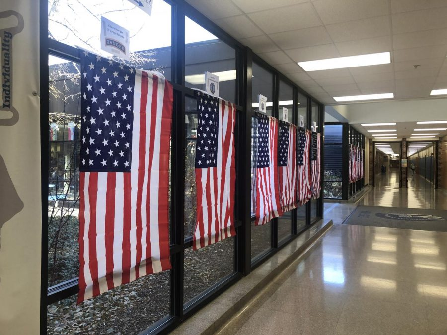 The+11+flags+hanging+in+East%27s+main+hallway+to+honor+its+veterans.