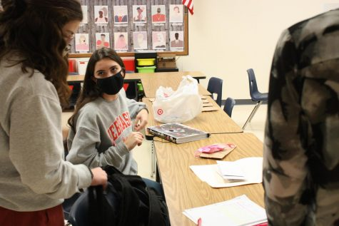 StuCo selling masks after school to raise money for the Breast Cancer Foundation.