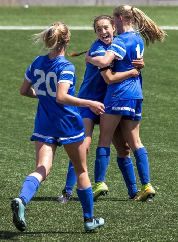 Thanks to Haley Peterson (center) and others, the Spartans prevailed over the Titans 6-4 in a high scoring affair.