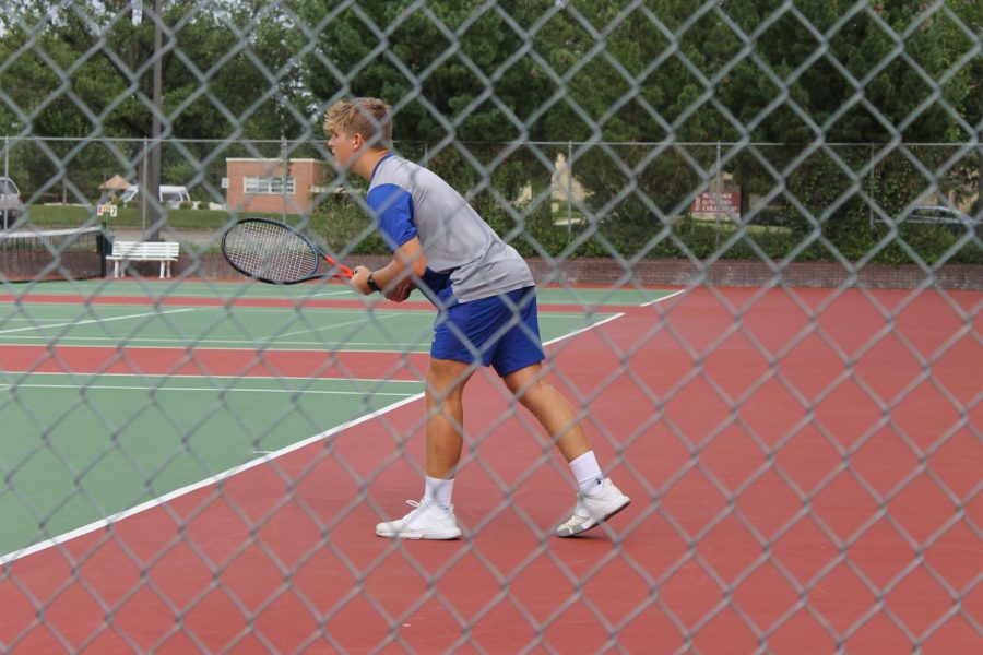 Sophomore Cole Mickells preparing for his next shot at the North Star vs East Varsity Dual at Woods Tennis Center. His 7 singles match ended with a final score of 8-0.