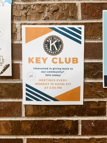 2021 Key Club poster hanging above a downstairs water fountain in the East High School building. Look for these posters around the school for more information to join!