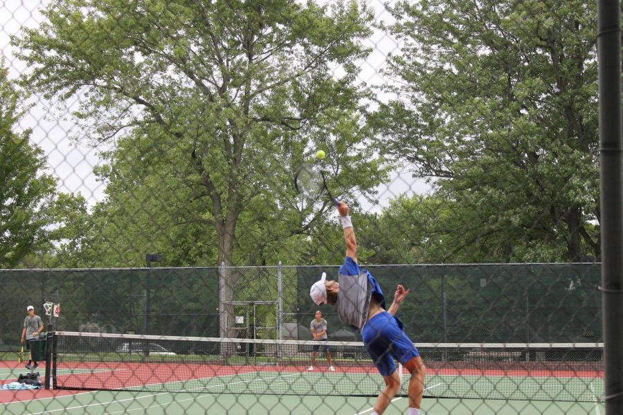 Sophomore+Mason+Garcia+hits+a+serve+at+the+North+Star+vs+East+dual+at+Woods+Tennis+Center.+Mason+Garcia+won+his+5+Singles+match+8-5+towards+the+beginning+of+the+dual.