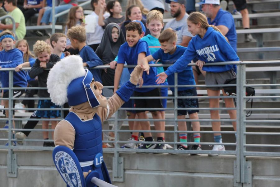 Martin the Spartan at Easts Friday 17, 2021 Football game. Pumping up the crowd while high fiving kids.