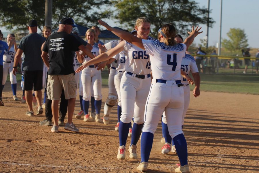 Morgan and Madison Adams celebrate their district final win against Fremont Thursday, October 8th at Doris Bair. This win punched the Lincoln East Varsity softball teams ticket to state.